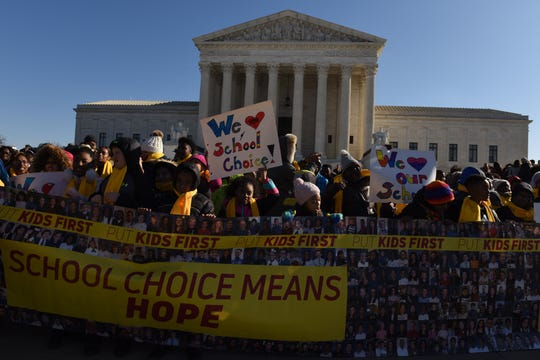 Demonstrators gather outside the Supreme Court on Jan. 22 as the justices hold oral argument in a case from Montana that could upend the funding balance between public and religious schools.