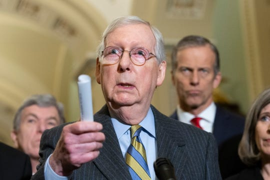 Republican Senate Majority Leader Mitch McConnell speaks to the media about the upcoming Senate impeachment trial on Capitol Hill in Washington, DC,  Jan. 14, 2020.