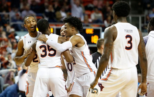 Jan 22, 2020; Auburn, Alabama, USA;  Auburn Tigers guard Devan Cambridge (35) is surrounded by teammates after scoring a three point basket during the first half against the South Carolina Gamecocks at Auburn Arena.