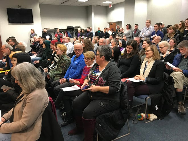 More than 100 people pack the Appleton Common Council chambers Wednesday, in large part to share their thoughts on a resolution to ban licensed medical and mental health professionals from practicing conversion therapy on minors.