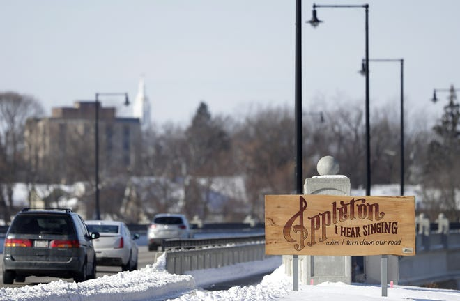 A welcome sign identifying Appleton and its ties to music greets motorists at the east end of the College Avenue bridge.