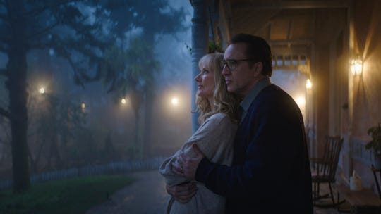 """Joely Richardson as Theresa Gardner and Nicolas Cage as Nathan Gardner in the sci-fi/horror film """"Color Out of Space,"""" an RLJE Films release."""