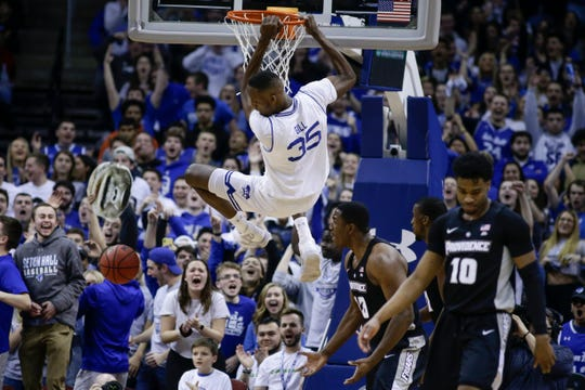 Providence's Kalif Young (13) and A.J. Reeves (10) react as Seton Hall's Romaro Gill (35) dunks the ball