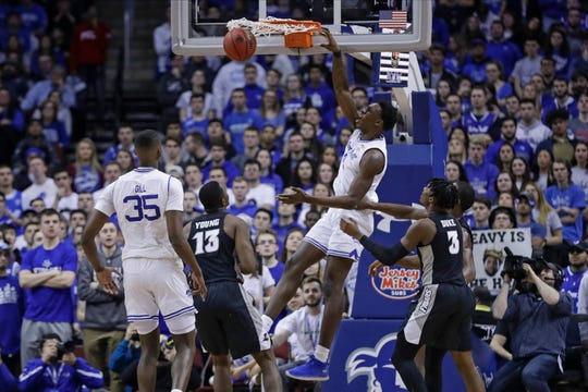 Seton Hall's Tyrese Samuel (4) dunks the ball in front of Providence's Kalif Young (13)