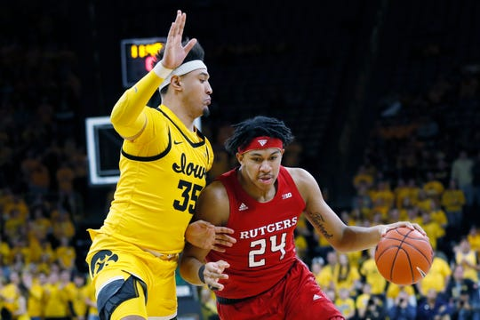 Rutgers guard Ron Harper Jr. (24) drives to the basket past Iowa forward Cordell Pemsl during the first half of an NCAA college basketball game, Wednesday, Jan. 22, 2020, in Iowa City, Iowa.