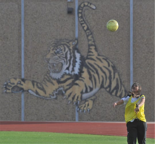 A Snyder soccer player throws in the ball during practice Wednesday, Jan. 8, 2020, at Tiger Stadium in Snyder.