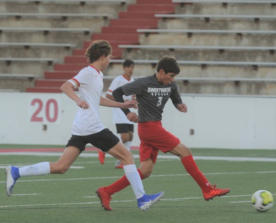 Sweetwater forward Jonathan Gallegos (3) dribbles past a Lubbock Coronado player in the Mustangs' inaugural game Tuesday, Jan. 7, 2020, at the Mustang Bowl in Sweetwater.