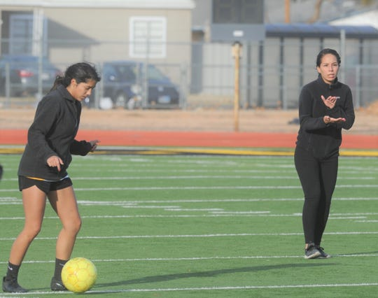 Snyder girls soccer coach Jessica Lima claps during practice Wednesday, Jan. 8, 2020, at Tiger Stadium in Snyder.