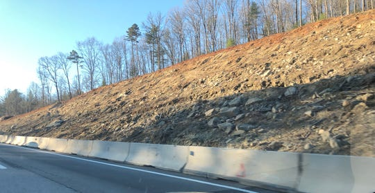 Sub-contractors are clearing trees and brush along I-26 as part of a widening project. The timber and other products from the wood, such as mulch, belong to those companies.