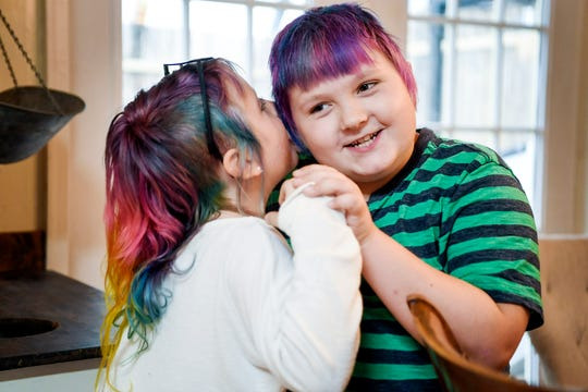 Emma Smith, 8, whispers into her 10-year-old brother Miller's ear January 17, 2020.