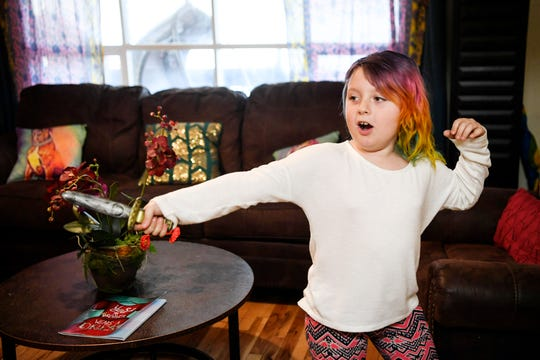 Emma plays with a toy dagger at her home in Arden January 17, 2020.