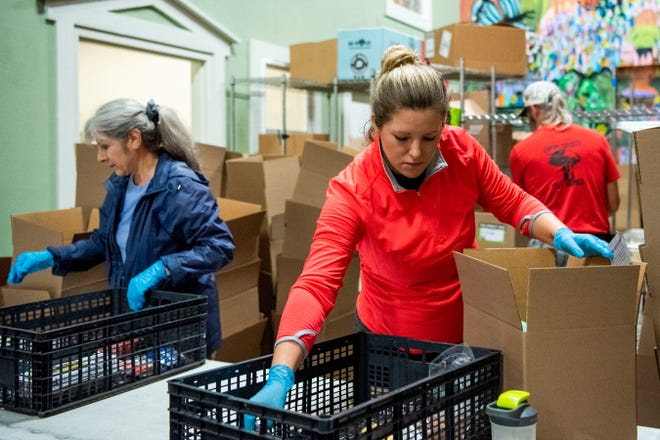 Volunteers assemble grocery orders on Wednesday, Oct. 2, 2019 at Sprout in Battle Creek, Mich.