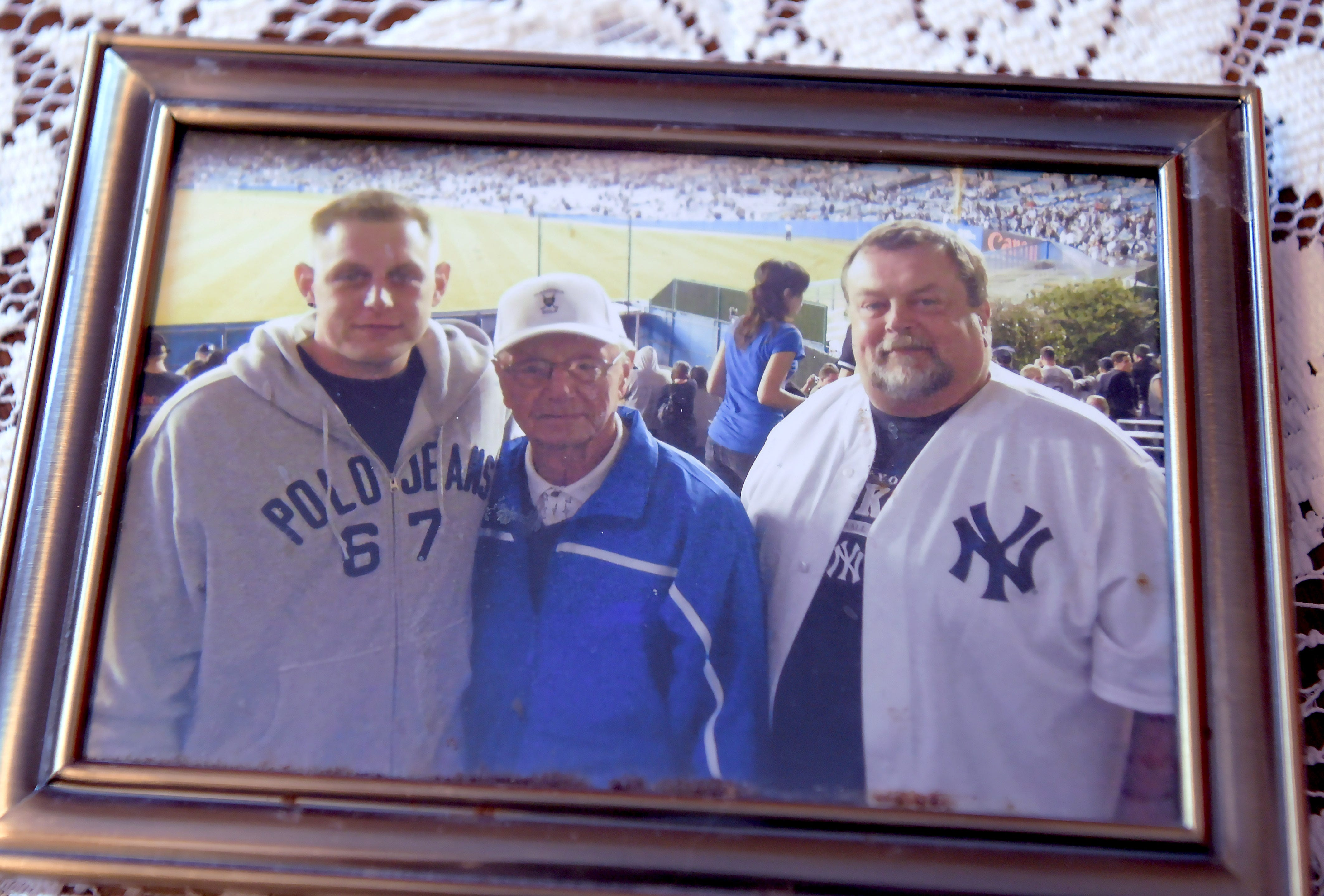 A photo of Tom Husar, left with his grandfather and father. Tom suffered from chronic disease and was in the Broome County jail on a probation violation when he died in November 2019