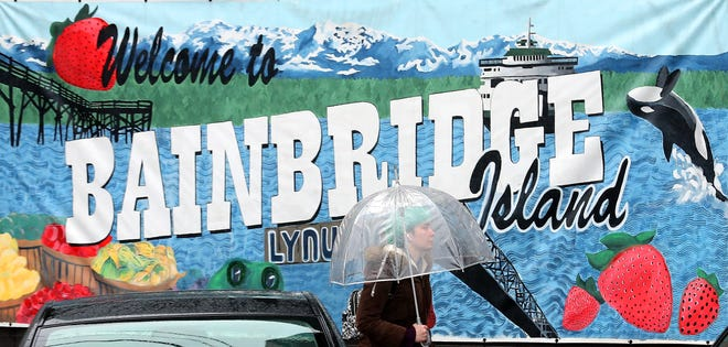 Myriah Riedel makes her way along the sidewalk of Bainbridge Island's Winslow Way on a very rainy Thursday.