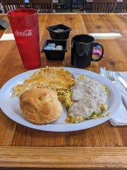 "Chris Romandetti: ""(I am) giving this new place a shot: the Country Barn Café (575 S. Wickham Road, Melbourne), on Wickham just south of Ellis. This is the Southern Scrambler: three eggs with sausage, onions, green peppers and topped with sausage gravy. Simple, yet delicious, and the gravy is very flavorful!"""