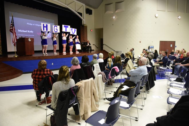 Crestline cheerleaders energize a crowd of residents Wednesday as city leaders announced that Crestline is hoping get a complete makeover by HGTV.