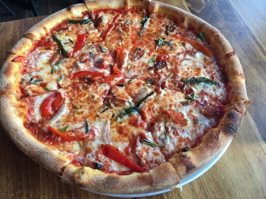 The Hunter pizza (house red sauce, glazed pork belly, charred peppers, grilled onions and rosemary) at Stone's Throw in Richmond on Jan. 21, 2020.