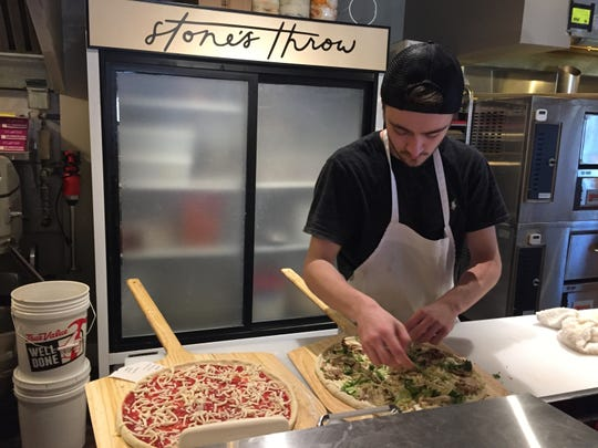 Ethan Harris prepares pizza at Stone's Throw in Richmond on Jan. 21, 2020.