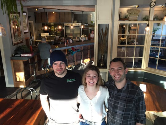 Stone's Throw owners, from left to right, Silas Pollitt, Allison Stratton and Tyler Stratton stand in the dining room of their new Richmond pizza restaurant Jan. 21, 2020.