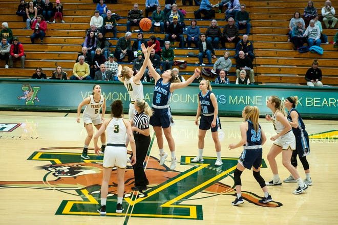 Vermont's Hanna Crymble (10) and Maine's Maeve Carroll (5) battle for the opening tip off during the women's basketball game between the Maine Black Bears and the Vermont Catamounts at Patrick Gym on Wednesday night January 22, 2020 in Burlington, Vermont.