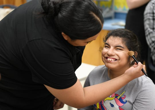 Daisy Cano smiles while getting her makeup done before the annual Special Hearts Prom, Thursday, Jan. 23, 2020, at Moody High School. Cano is in eleventh grade.