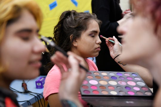 Mya Jimenez, center, gets her makeup done before the Special Hearts Prom, Thursday, Jan. 23, 2020, at Moody High School. Jimenez is a freshman.