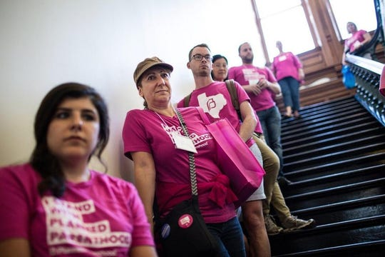 Planned Parenthood supporters gathered at the Texas Capitol in 2017 to promote the organization. It was kicked out of the state's health program for low-income women.