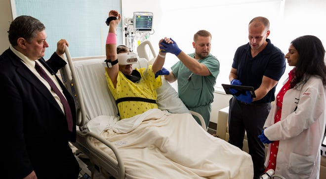 A Cooper University Health Care patient demonstrates how new virtual reality technology can be used during rehab following a stroke. The Camden hospital says it is the first in the world to incorporate the rehabilitation tool into its stroke program.