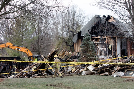 Rescue workers continue to sift through burned debris of a home in the Triple Crown neighborhood of Union, Ky., while searching for an unaccounted resident on Thursday, Jan. 23, 2020. The building burned on Tuesday, Jan. 21, 2020.