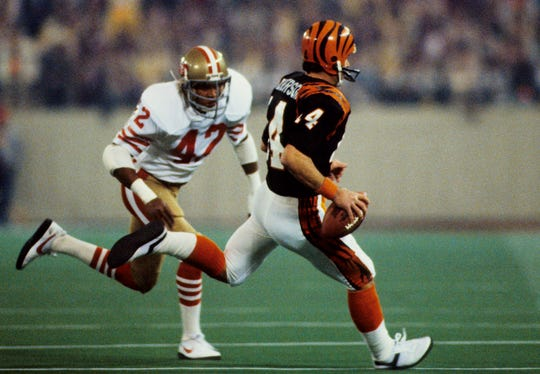 Jan. 24, 1982: Cincinnati Bengals quarterback Ken Anderson (14) runs toward the sideline under pressure from San Francisco 49ers defensive back Ronnie Lott (42) during Super Bowl XVI at the Pontiac Silverdome. The 49ers defeated the Bengals 26-21.