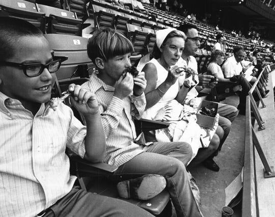 JUNE 30, 1970: Riverfront Stadium, opening night. Keith Simpson, 11, Barry Craig, 10, and Mrs. and Mr. Peter Craig of Blanchester, Ohio. The Enquirer/Bob Free