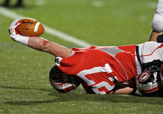 Nov. 28 2014: Dixie Heights RB Luke Zajac stretches for a TD in the game with Louisville Ballard Bruins.