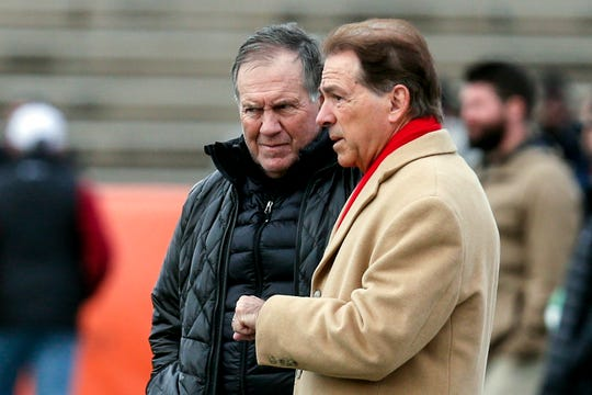 Bill Belichick, New England Patriots coach, talks with Nick Saban, Alabama head coach, during practice for the Senior Bowl Wednesday, Jan. 22, 2020, in Mobile, Ala.