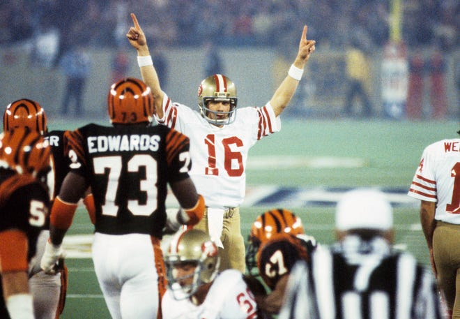 Jan 24, 1982: San Francisco 49ers quarterback Joe Montana (16) reacts at the line of scrimmage against Cincinnati Bengals defensive end Eddie Edwards (73) during Super Bowl XVI at the Pontiac Silverdome. The 49ers defeated the Bengals 26-21.