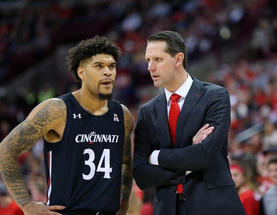 University of Cincinnati men's basketball head coach John Brannen talks to Bearcats senior guard Jarron Cumberland during the first half against the Ohio State Buckeyes at Value City Arena on Nov. 6, 2019.