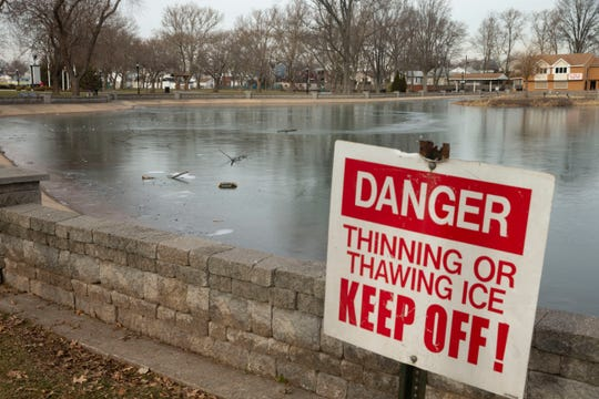 Thin ice sign around the pond in Carteret Park Thursday afternoon, January 23, 2020.   A young man who fell through an icy pond here was being transported to University Hospital in Newark Wednesday night and later died there.