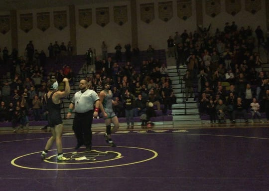 Chris Fanelli celebrates dual-meet clinching victory that seals Monroe's historic win over South Plainfield