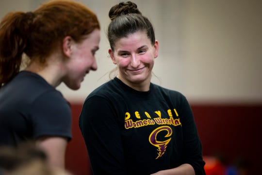 Denver girls wrestling coach Cassy Herkelman, right, talks to Lauren Nicholas during a morning practice on Wednesday, Jan. 22, 2020, in Denver. Herkelman was one of the first true trailblazers for girlsÕ wrestling in Iowa and now she is back coaching the Denver girlsÕ wrestling team while also working full time as a police officer.