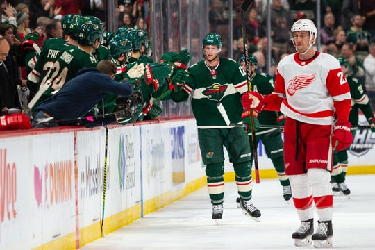 Minnesota Wild center Eric Staal (12) celebrates with teammates after scoring a goal during the second period against the Detroit Red Wings, Jan. 22, 2020 in Saint Paul, Minn.
