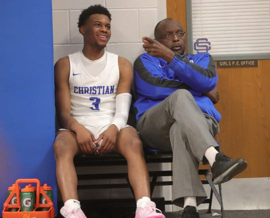 Southfield Christian head coach Clennie Brundidge and Da' Jion Humphrey on the bench during action against Inter-City Baptist high school in Southfield, Tuesday, Jan. 21, 2020.