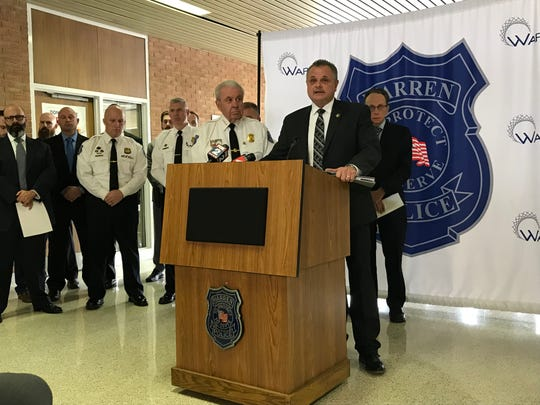 Mark Jankowski, acting U.S. Marshal for the Eastern District of Michigan, center, talks about the five-day effort to arrest 50 fugitives out of Warren with Warren Police Commissioner Bill Dwyer, left, and Warren Mayor Jim Fouts, right, at Warren Police Headquarters on Jan. 23, 2020.