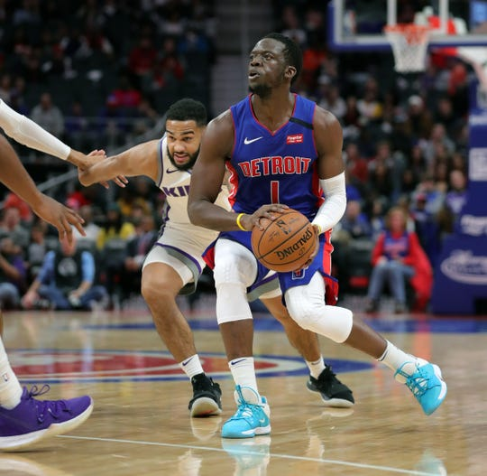 Reggie Jackson drives against the Kings during the first period Wednesday at Little Caesars Arena.