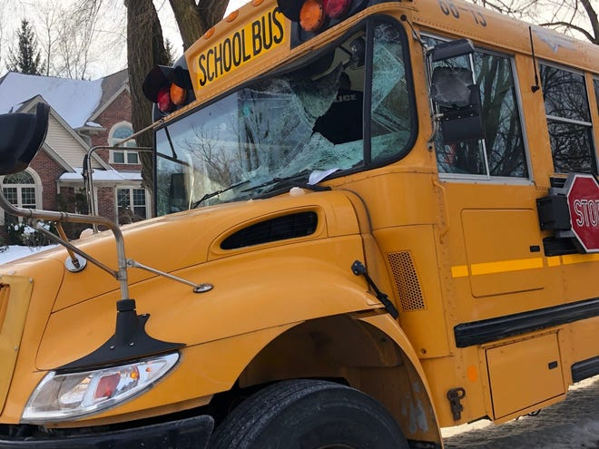 A Utica Community Schools bus is shown damaged after it was struck by ice from another vehicle during the after-school drop-off. Police were called about 3:15 p.m. Jan. 21, 2020, to 25 Mile Road and Van Dyke Avenue in Shelby Township for the crash.