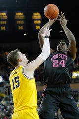 Penn State forward Mike Watkins shoots on Michigan center Jon Teske in the second half at Crisler Center, Jan. 22, 2020.