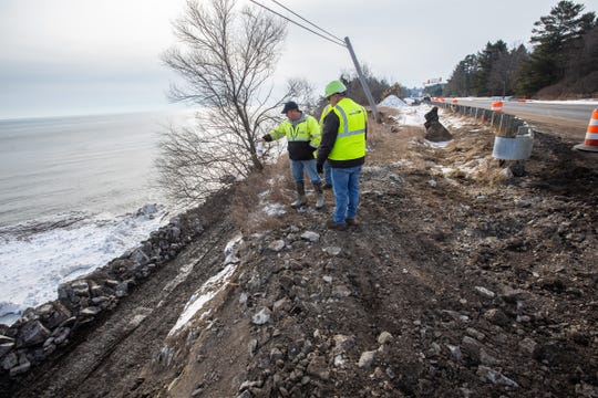 Sanilac Township Road Commission workers discuss next steps to stabilize a section on land off of M-25 in Lexington Township on Thursday, January 23, 2020 that is damaged due to erosion from Lake Huron.