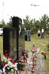 Friends, family and visitors stopped by to pay their respects and remember their loved ones on Thursday, Aug. 16, 2012, at the crash/memorial site of the passengers of flight 255, a Northwest flight which crashed after takeoff in Romulus on Aug. 16, 1987.
