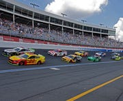 In this Sept. 29, 2019, file photo cars drive through Turn 4 to start the NASCAR Cup Series at Charlotte Motor Speedway in Concord, N.C. General Motors is planning to open a new technical center for performance and auto racing near the Charlotte Motor Speedway.