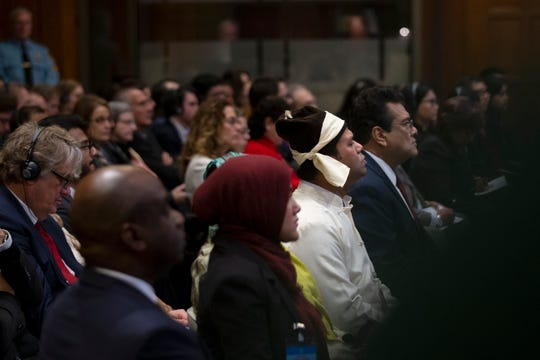Representatives of the Rohingya community listen as the presiding judge read the ruling at the International Court in The Hague, Netherlands, Thursday, Jan. 23, 2020.