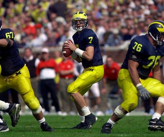 Michigan quarterback Drew Henson drops back during a win over Wisconsin in 2000.