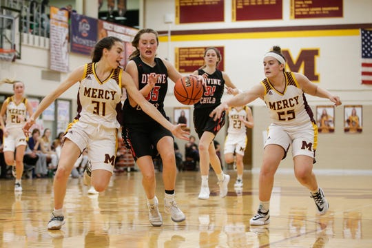 Farmington Hills Mercy's Julia Bishop will play volleyball at MSU, but for now is focusing on helping the basketball team keep winning.